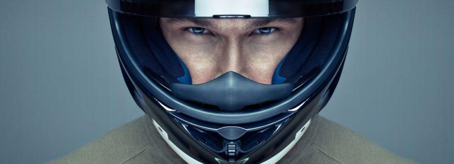 A man in a motorcycle helmet.