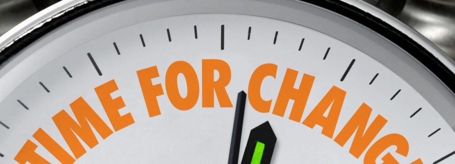 """A clock with """"Time to Change!"""" in orange lettering"""