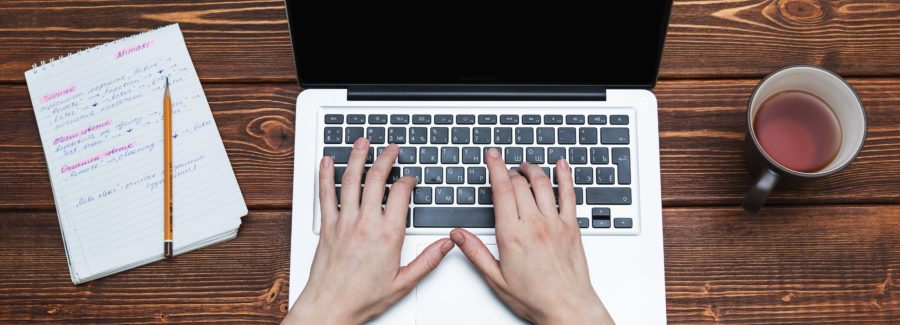 Woman works on computer
